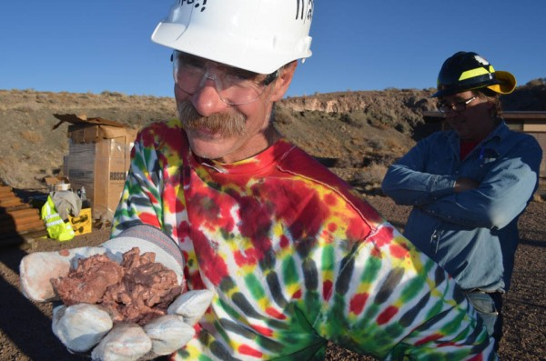 With a delight that perhaps only a geologist can evince for a handful of mud, Geissman presents debris from the borehole. The bright colors in the rocks come from chemical reactions involving iron and other elements. (The tie-dyed colors in Geissman's shirt come from his avowed dedication to another long-ago era, known to scientists and others as the 1960s.)