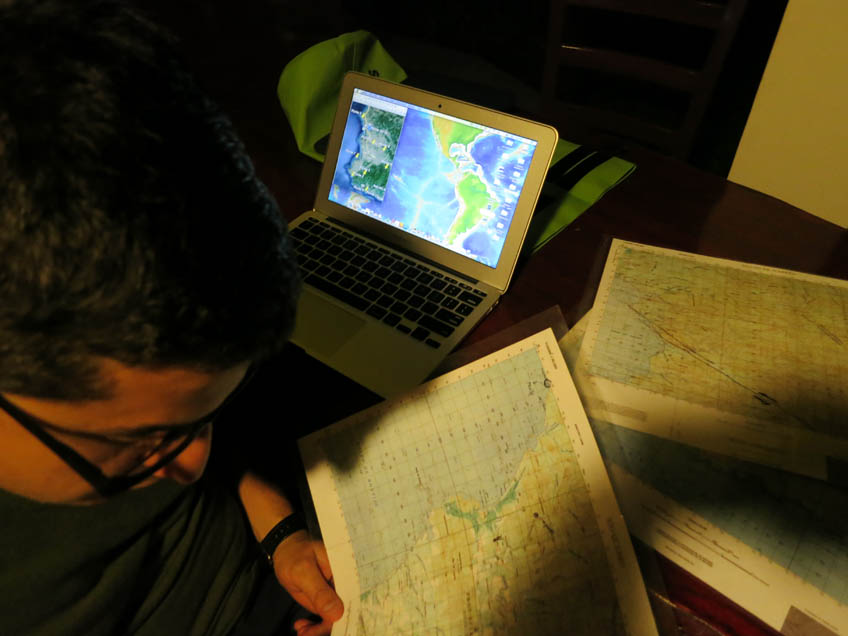 After dark, the team pores over large- and small scale maps, to pinpoint likely collection sites.