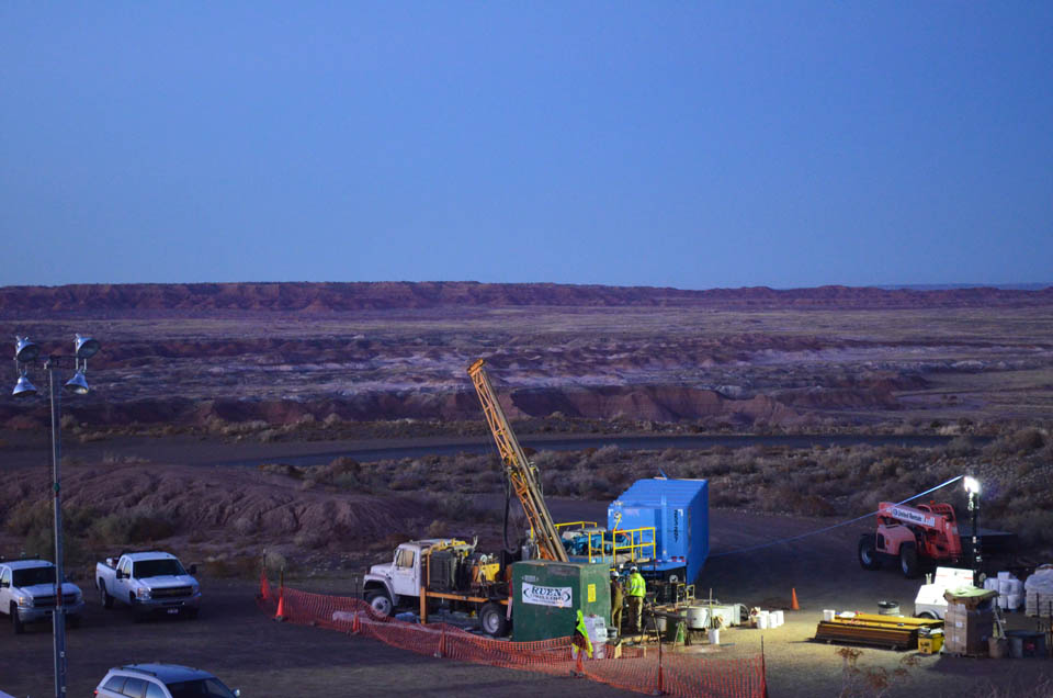 The team's drill--here seen at sunset--has been planted at the edge of a butte. The crew runs it in shifts 24 hours a day. The monthlong drilling is supervised by a consortium of scientists from different universities, and funded by the National Science Foundation, The borehole will eventually bottom out at 1,706.5 feet.