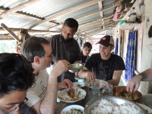 Mr Islam serves Scott and myself more of the delicious lunch they had prepared.  Eaten with our hands, of course.