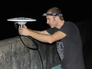Scott adjusting the GPS antenna at the new Khulna site, working into the night.