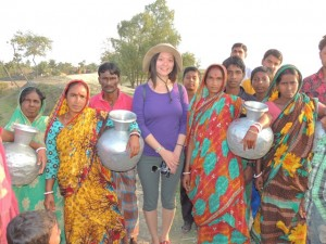 Soyee with some of the local women and their water jugs on Polder 32.