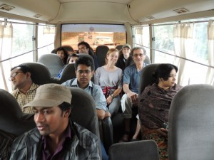The American and Bangladeshi students, along with our instructors get to know each other on the bus as we transition from metropolitan traffic to driving by green rice fields.