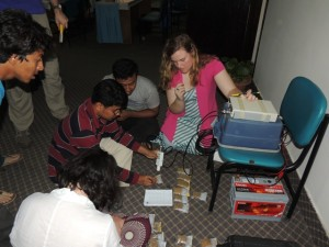 A group of students measure magnetic susceptibility of well samples that were collected the day before. The measurements help distinguish whether the sediments were deposited by the Brahmaputra or other rivers.