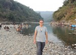 Standing in India by the Dauki River and Shillong Plateau at Jaflong..
