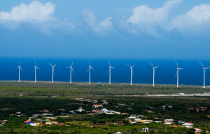 A recently built wind farm in Aruba supplies 20% of the island's electricity. Photo: PM Mike Eman presentation