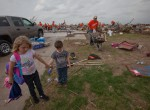 Moore, Okla., May 29, 2013 -- Moore residents visit their tornado destroyed property as volunteers clean up the debris. The Moore area was struck by a F5 tornado on May 20, 2013. Andrea Booher/FEMA