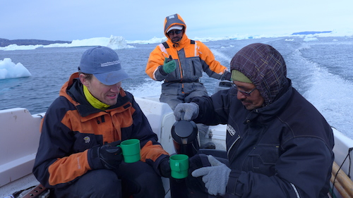 Dave Porter and Magnus Petersen enjoy a koffemik while Gabriel navigates with the GPS (Photo M. Turrin)