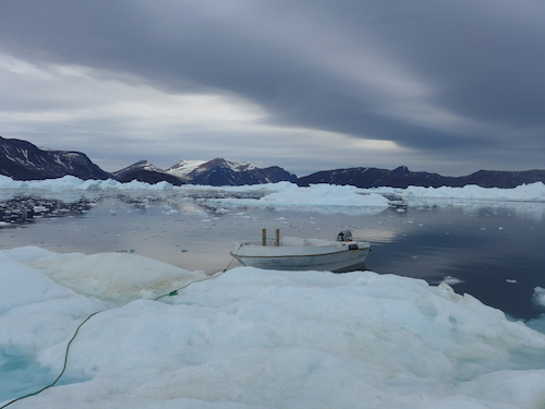 Tying up on the iceberg to check for access in the mélange. (Photo M. Turrin)