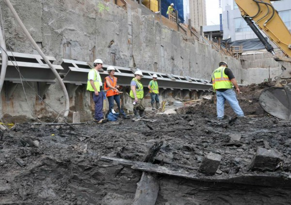 "Archeologists monitoring excavation at the former World Trade Center site stopped work on the morning of July 13, 2010 after spotting a pair of curved timbers poking out from the mud. ""It has to be a ship,"" AKRF archeologist Molly McDonald (in orange) said at the time."