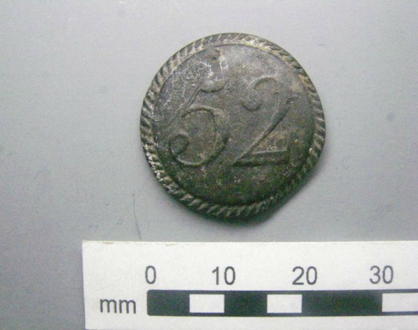 "A pewter button stamped with the number ""52"" was found wedged in the ship's stern; it may have belonged to a soldier from Britain's 52nd Regiment of Foot, a light infantry unit that fought at Lexington and Concord, among other Revolutionary War battles."