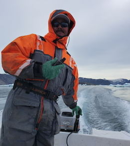 Gabriel Petersen navigates through the ice with the GPS (Photo M. Turrin)