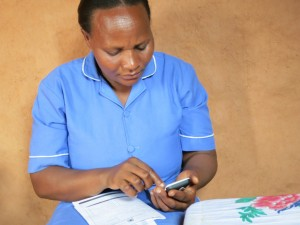 The use of smartphones by community health workers will be a key component of tracking Ebola cases. Photo: One Million Community Health Workers Campaign.