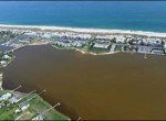Aerial view of a brown tide caused by Aureococcus anophagefferens. Long Island. Photo by Chris Gobler.