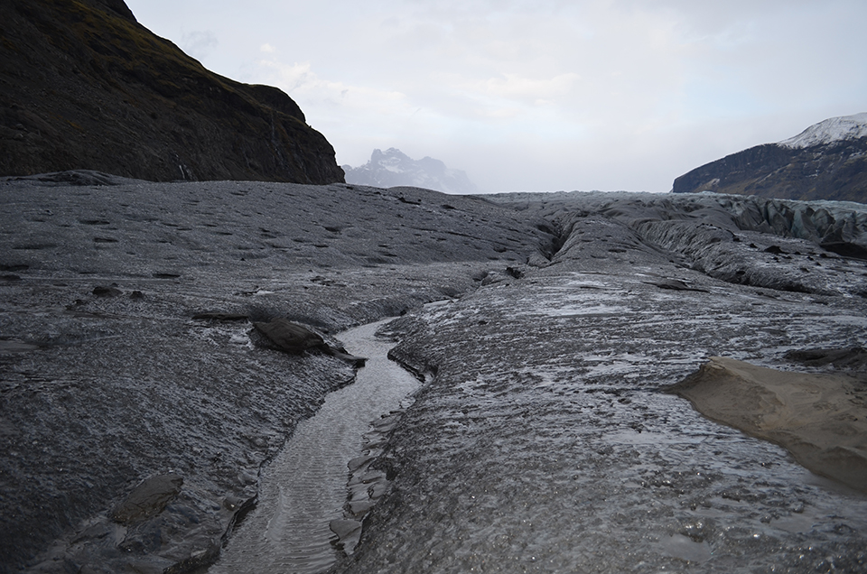 The rapidly wasting surface of the Skaftafellsjokull glacier concentrates a monochrome of rocky debris; the dark coating absorbs solar radiation, which in turn encourages more melting.