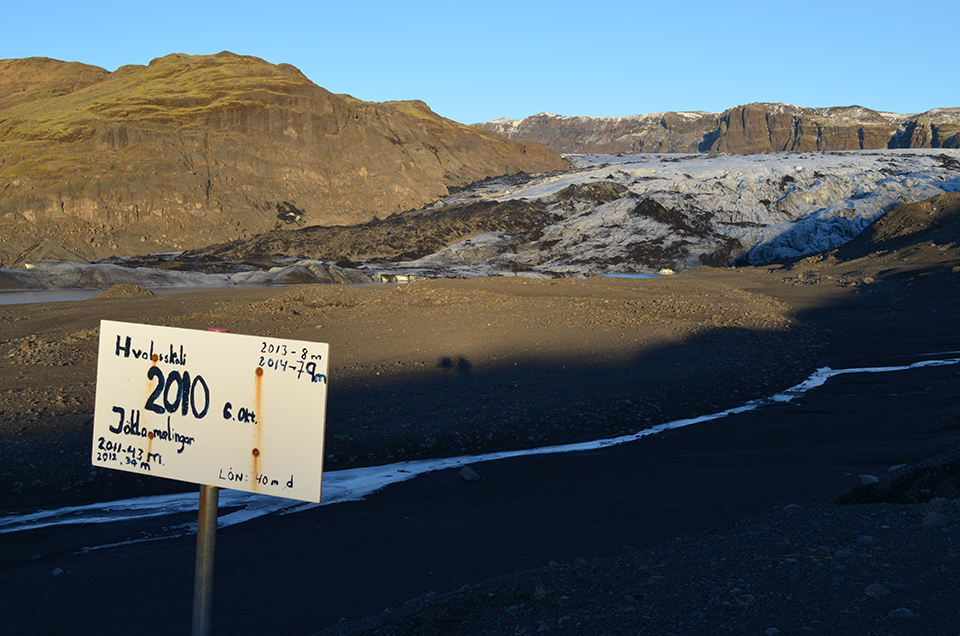 Volunteers from the Iceland Glaciological Society have spent decades measuring the decline and fall of the once-mighty Solheimajokull glacier. A sign planted where ice stood just a few years ago records the most recent declines. If trends hold up, by 2100 Iceland may be mostly land and very little ice.