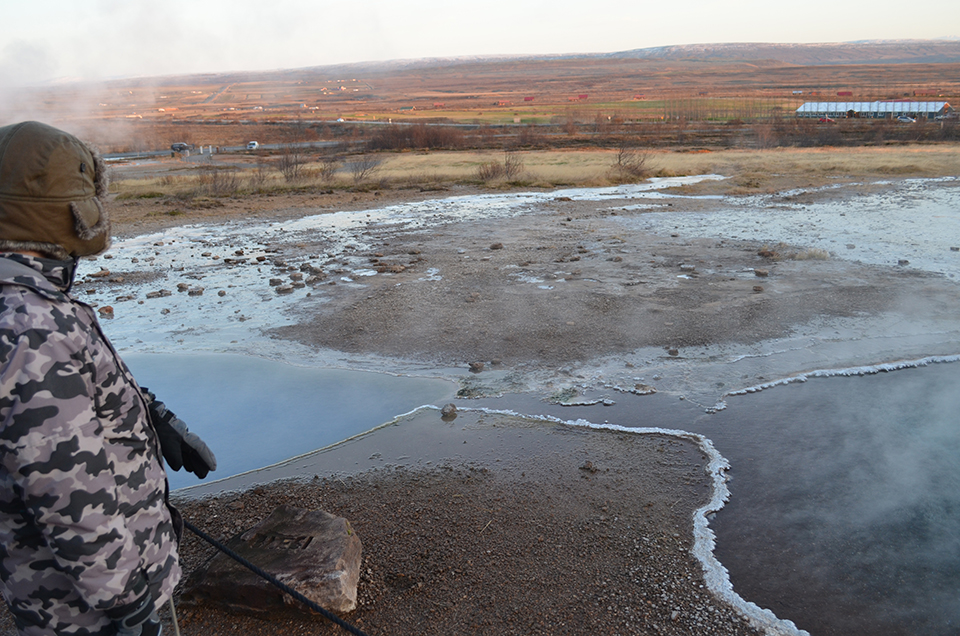 At tourist-friendly Geysir, fountains of volcanically-driven water periodically erupt from hot pools like this one. Around the edges, white carbonate crusts have formed, as minerals precipitate out—a natural analog to the processes harnessed at Hellisheidi. Geysers worldwide get their name from Geysir.
