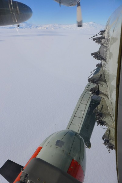 Icepod flies over the Antarctic ice with Mt. Erebus visible in the background. (Photo R. Bell)