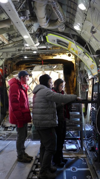 Scott Brown, Tej Dhakal and Winnie Chu prepare the equipment for take off. (photo R. Bell)