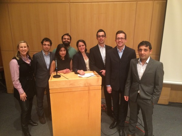 Members of the Impact Investing Capstone Workshop team pause for a photo with their faculty advisor, Jessica Prata.