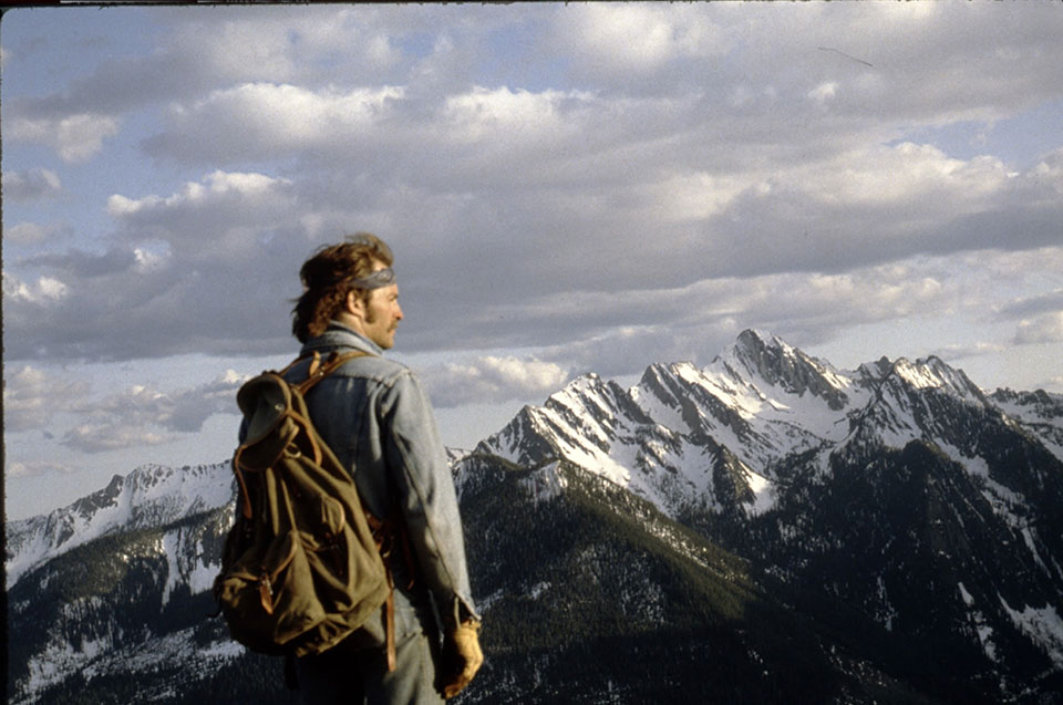 In 1980s and 1990s, prospecting teams worked their way northward through remote terrains, including the Canadian Rockies, where this crew member was landed by helicopter.  (Courtesy Paul Derkson)