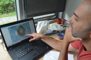 Yaakov Weiss inspects the digitized image of one of the many diamonds he has analyzed.