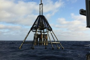 Another type of coring device collects sediments at the seafloor surface. The tent-like structure here slows down the apparatus as it nears the seafloor, allowing six corers to gently sink into the top layer of mud without scattering the sediments. (Gisela Winckler)
