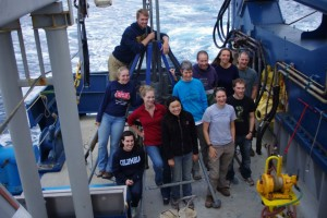 As the ship cruised back to Astoria, the coring team took advantage of a rare moment of downtime to pose with the Multi-Corer tent before it was packed away for the next expedition. (David Ferguson)