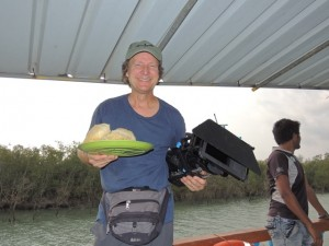 Doug balancing his camera and his breakfast of puri and dal on the Elmar, our boat for the day