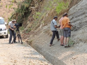 Doug Prose filming Nano, Paul and Humayun at an outcrop