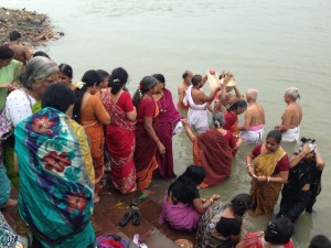 A funeral procession arrived to scatter ashes in the Hooghly (Ganges) while we were filming