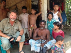 Chris interviewing Bangladeshi farmers about the history of the area