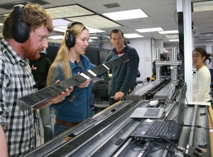 Researchers examine cores of sediment drilled from the deep seabed.