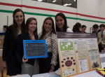 "A group of students showcase their Commitment to Action, the ""Malaria Awareness Program"", at the annual Clinton Global Initiative meeting"