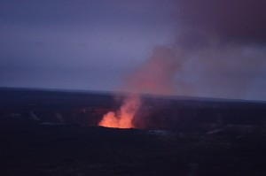 At dusk, a fiery plume dominates the summit of Kilauea, whose eruptions have formed, and destroyed, the landscape for many miles around.