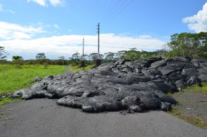 Lava laps across a road near the town of Pahoa. The latest eruption, which started in summer 2014, is not over; it may still overrun larger parts of town.