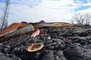 The remains of a house in the way of an ongoing lava flow near Pahoa, Hawaii. Volcanic eruptions are a way of life here. CLICK TO VIEW SLIDESHOW