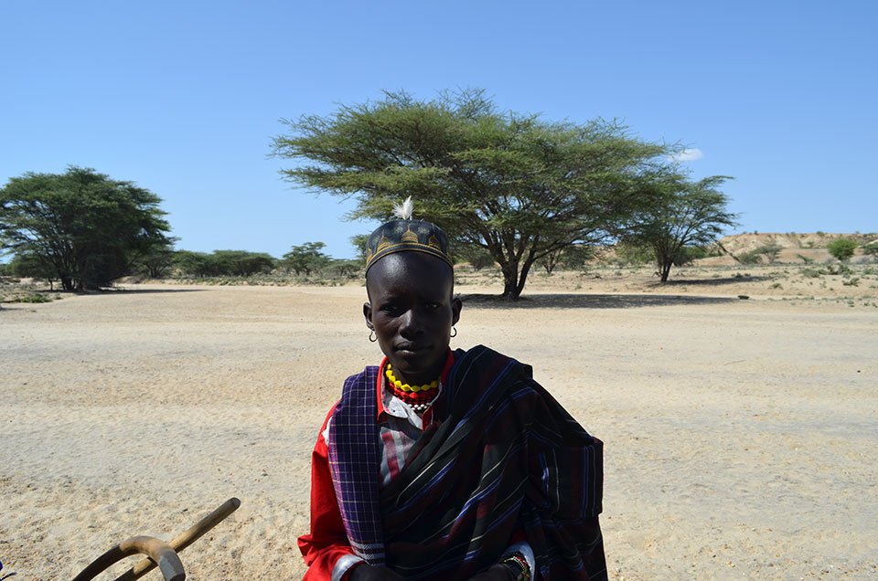 A Turkana herder stops by. Many Turkana remain deeply traditional, retaining their own language, religion and clothing.