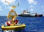 The global ocean buoy network has been expanding in recent years. Accounting for small, consistent offsets between temperatures measured by buoys and by ships reveals a greater global warming trend than previously calculated for the past 15 years. Image: Maintenance workers on an ocean buoy, NOAA.