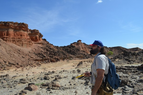 Geologist Christopher Lepre studies rocks in the Turkana region of northwest Kenya, where many of the most important fossils and artifacts from early humans are found.
