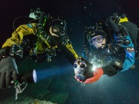 Scientists studying the 12,000 year old remains of a teenaged girl in a submerged cave in the Yucatan. Photo: Paul Nicklen/National Geographic