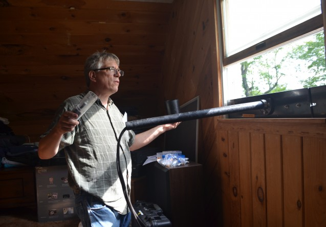 Geochemist James Ross of Lamont-Doherty Earth Observatory installs an air-quality monitor in a home neighboring a hydraulic-fracturing drill pad. CLICK FOR A SLIDESHOW