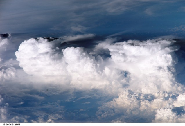 A cluster of towering cumulus clouds off the coast of El Salvador. The photograph was taken on May 31, 2002, from the International Space Station. Image courtesy of the Earth Science and Remote Sensing Unit, NASA Johnson Space Center, at http://eol.jsc.nasa.gov [Photo ID ISS004-E-12656]