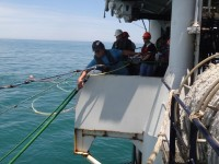 Crew aboard the R/V Marcus G. Langseth deploy hydrophone streamers for seismic mapping of the sea floor. Courtesy of Greg Mountain.