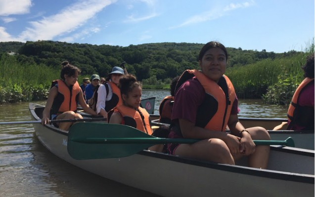 For New York City students accustomed to subways and sidewalks, the marsh required new skills beyond environmental science. Alondra Cruz paddles a canoe with Stephanie Valentin and Anjelle Martinez.