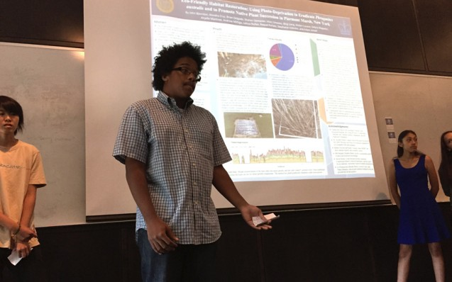 The six-week program wrapped up with presentations by each team of their summer fieldwork and findings. Brian Delgado and his teammates present their marsh rehabilitation work.