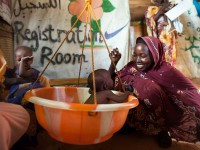A woman weights her child with malnutrition in a clinic in North Darfur. Photo: Albert González Farran, UNAMID