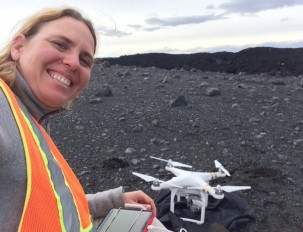 Einat Lev with Buzz, the unmanned aerial vehicle used to map the lava flow.