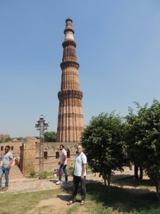 Standing in front of the 240-foot tall Qutub Minar, which dates from the 1200s.