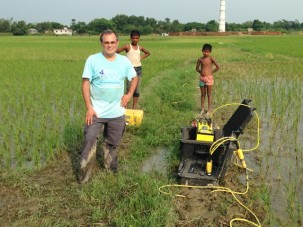 Standing ankle deep in mud by the resistivity meter.  The smokestack of the brick factory can be seen in the distance.